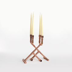 Copper candlestick. these are stunning....if I didn't already have way too many copper & brass candlesticks, I might have to pop for these.
