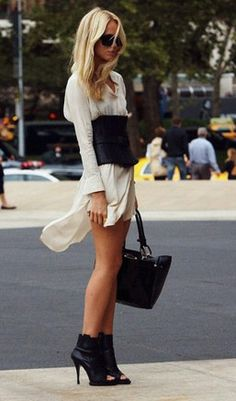 Elin Kling, swedish blogger looks incredible paring a white tee dress, corset, and open toed boot. Black and white never looked cooler. The look needs to be tempered with natural, loose waves, and as always for chic, black sunglasses.