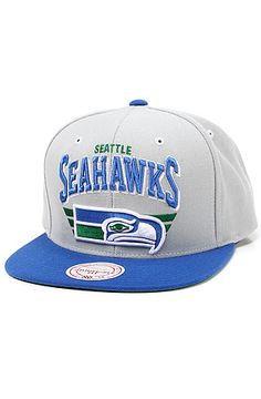 Mitchell   Ness The Seattle Seahawks Stadium Snapback Cap in Grey   Blue   Team logo embroidered on the front  Brand logo on the back  Team colors on  brim ... bf67078a8071