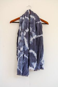 This listing is for a hand-dyed shibori scarf with raw edges, made of a linen-rayon fabric blend.  Shibori is an ancient Japanese resist-dyeing technique in which the fabric is bound up with string before going in the dye-bath. This process results in a unique dye-pattern each time. The scarf pictured is the exact one you will be receiving.  Approximate dimensions: 59 long x 25 wide  The fabric has been washed before and after dyeing. Hand wash in cold water with gentle detergent. Hang to…