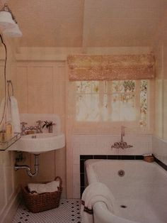 Corner wall mount sink - super cute little vintage bathroom... love that this corner sink has the old backsplash too