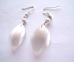 White upcycled earrings made of recycled plastic by dekoprojects, $11.50
