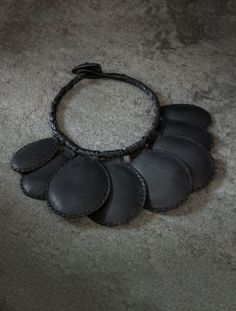 - Description - Details - Customer Care Designed in collaboration with Haitian artisan Pascale Théard, this tribal-inspired collar blends indigenous Haitian art with fine leatherwork for a global acce