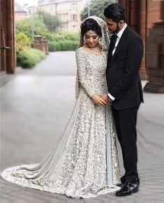 33 Pakistani Bridal Lehenga Designs to Try in Wedding - LooksGud.in - Pakistani Silver All Over Worked Bridal Dress Source by - Indian Wedding Gowns, Asian Bridal Dresses, Pakistani Wedding Outfits, Indian Bridal Outfits, Pakistani Wedding Dresses, Bridal Wedding Dresses, Indian White Wedding Dress, Walima Dress, Wedding Hijab