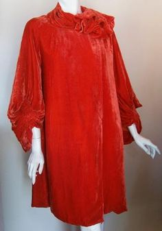 Brilliant poppy red silk velvet late  20s opera coat with florette detail  at neckline with scarf wrap tucking  beneath.