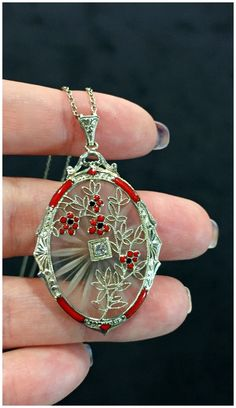 An exceptionally lovely antique camphor glass pendant with filigree and floral enamel details