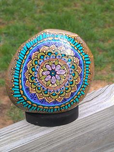 Hand painted spring mandala on river rock