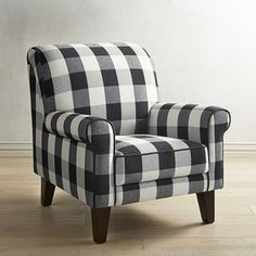 If you were a chair designer, what would be on your short list of must-have features? Comfort, of course. Style that's fresh yet timeless. Quality is important, too. Well, all that and more describes our Lyndee Armchair. Rolled arms and back, a classic check pattern and handcrafted durability. Nice work!