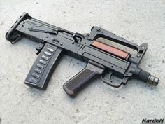 """""""Groza"""" OC-14 / OTs-14 modular assault rifle. Caliber, mm: 9x39 SP-6, 7.62x39 M43, Action: Gas operated, rotating bolt with 2 lugs, Length: 610 mm (with grenade launcher installed), Barrel length: 240 mm, Weigth: 2.7 kg, Magazine: 20rds (9mm), 30rds AK-47 type (7.62mm), Rate of fire: 700 rounds per minute"""