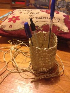 A raffia pot hand woven on my hand held loom kit.