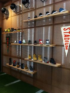 Pegboard shoe display at Nike stadium new york. #retail #merchandising #pegboard #display