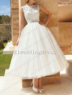 Tea-length wedding dress...I kind of want the traditional length but oh my goodness I love this!!!