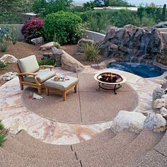 50  landscaping ideas with stone   Connecting with your surroundings   Sunset.com   A circular patio of tinted concrete aggregate is edged with rose flagstone. The naturalistic spa backing, tough plantings, and the paving's rosy tones visually connect the patio to the surrounding desert.
