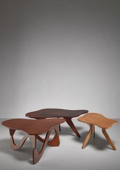 A set of three plywood freeform coffee tables by Brazilian designer José Zanine Caldas.  Labeled underneath.