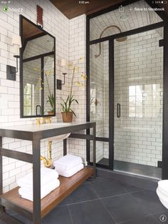 Subway tiles, black shower doors