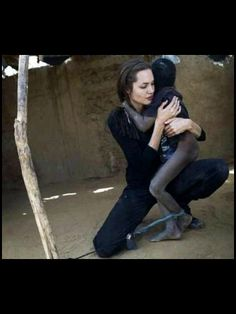 Angelina Jolie is a true humantarian worker.. She wasn't afraid to give an affection  and caring toward that child.