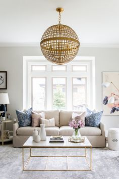 Unique metal chandelier for your living room: http://www.stylemepretty.com/living/2016/08/31/do-away-with-matchy-matchy-and-mix-metals-like-a-true-designer/ Photography: Travis J - http://www.travisjphotography.com/