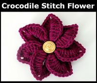We designed this free Crocodile Stitch Flower to help give a little extra pop to accessories, home decor, and even gift wrappings. You can make these in all the