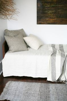 White, grey, and dark wood...and those textures look warm, inviting, and cozy