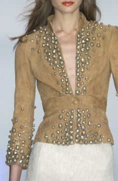 Sueded caramel tan jacket with stand neckline, raised-waist, and gold sparkling embellishments. By Valentino 2004