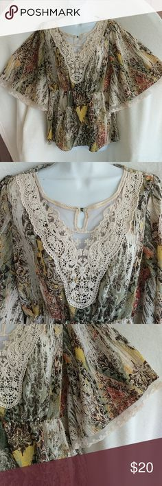 Bandolino Women's Size M Batwing Tunic . Bandolino Women's Size Medium batwing tunic . With Crochet lace neckline and lace batwing sleeve trim . Like new worn once . Gorgeous Autumn colors . Beautiful . Gently used . Bandolino Tops Tunics