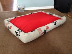 DIY dog bed using scrap fabric, a 2x4 and some stuffing from old pillows.  I'm putting this one in the master bedroom.