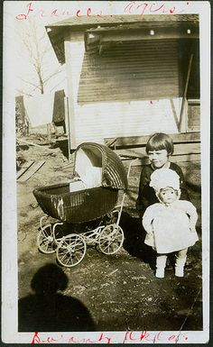Child with buggy and doll 1920's