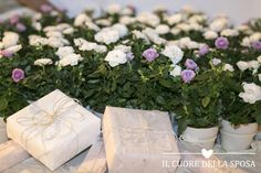 "table of #wedding #favors.  ""A #rose for you"" -  Il Cuore della Sposa Wedding Planner & designer - Photograper @Cristiano Ostinelli  - www.ilcuorewedding.eu"