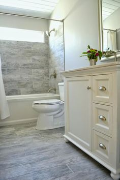 This frighteningly close to my ideas for our bathroom. Same Dapple Gray plank tile which i now see will also work for the surround, same tub, same wall colors, same color fixtures. We will have an espresso vanity, white top, maybe bring tile to the ceiling.