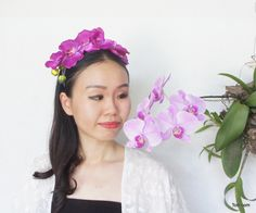 Look stunning and gorgeous with this purple orchids headpiece. This headpiece is made from artificial purple colour orchids which attached to purple headband. The headband is first wrapped with purple ribbon and then attached with orchids. For the tidiness, the back part of the headpiece will be ...