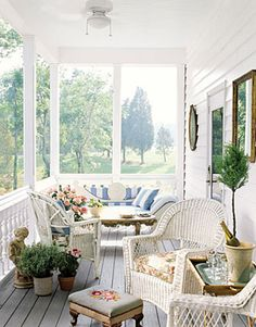 White Porch  Comfortable furniture covered in weather-resistant fabric makes this wide front porch feel like an extension of the living room. Mirrors on the wall reflect the trees in the yard, while pale blue paint on the ceiling mimics fair-weather sky.