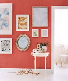 Engage visitors immediately by creating an eye-catching wall display. Here, extra pieces of wallpaper are framed eclectically.