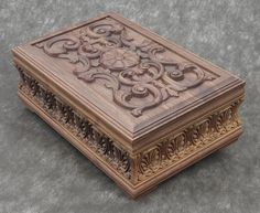 Luxury carved jewelry box made of selected walnut wood (American walnut), inside is upholstered in white velvet. Outside is varnished with polyurethane environmentally friendly resins. Brass hardware - is plated with 24 carat gold coverage.    Dimensions:  width 26 cm  length 40 cm  height 15 cm  all size are within +/- 0.5 cm  Weight - 3,4 kg / 7,5 pounds (lbs)    It can be done in different wood, finishing and size on request.  Can be chosen differently colored velvet which can be…