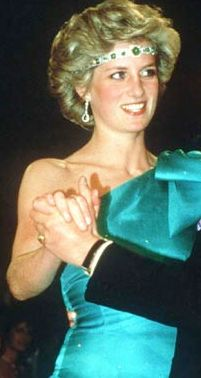 Princess Diana wearing an emerald and diamond chocker given to her by Queen Elizabeth, worn as a headband