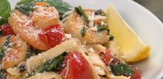 Close-up of shrimp tomato and spinach pasta on white plate:    I would make it without the shrimp