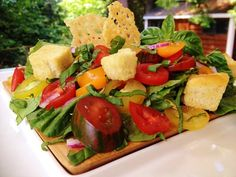 Rustic Bruschetta Salad with homemade Garlic Croutons and Parmesan Crisps.
