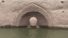 A carved Buddha emerged from a cliffside as water levels fell in a reservoir in East China. Taoism, Buddhism, The Weather Channel, China, Chinese Culture, Year Old, Archaeology, Mists, Underwater