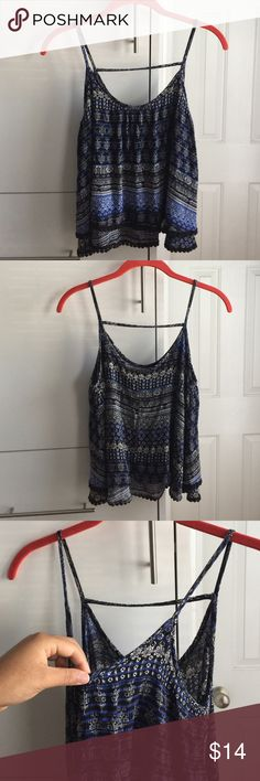 Beautiful layered tank This cute top has a beautiful print. It has two layers and has been worn once. It also has a trendy horizontal strap in the back. Tops Tank Tops