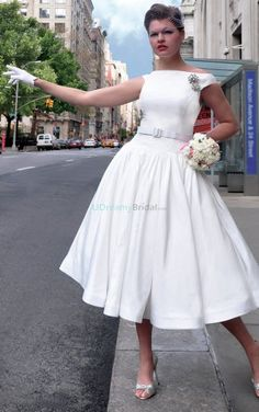 Vintage inspired wedding dress withboat neckline and tea length. A beaded brooch adorns theright shoulderwhile self-belted design slims the waist. Free made-to-measurement service for any size. Available colors seen as in Color Options.