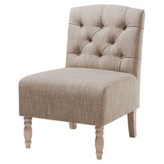 Perfect for curling up with your latest book club read or a cup of coffee, this elegant accent chair showcases a slipper design and button-tufted back.