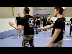 KRAV MAGA TRAINING • How to disarm a knife in your back