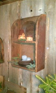 Primitive Red Cupboard...filled with old wooden plate, sugar cones, &...pine...simply Christmas.