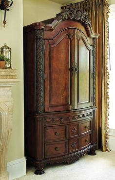 The armoire is tall and has multiple drawers and working doors Broyhill Furniture, New Furniture, Bedroom Furniture, Mattress Frame, Antique Armoire, Comfy Bedroom, Types Of Beds, Jewelry Armoire, Furniture Collection