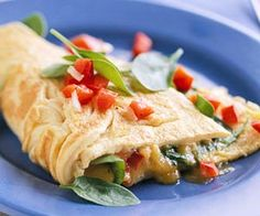 Easter Brunch Recipes Spinach and Cheese Omelet Cayenne pepper and chives spice up the eggs in this fresh omelet; baby spinach leaves and red peper relish add a healthy flavor twist Egg Recipes, Brunch Recipes, Breakfast Recipes, Cooking Recipes, Breakfast Omelette, Brunch Ideas, Breakfast Bites, Breakfast Club, Gourmet