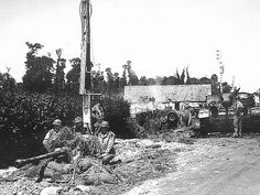 US 57 mm AT with crew. Destroyed Stug in the background. Normandy 1944