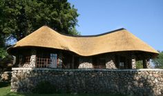 Owners of thatched roofs face different challenges than other property owners. Learn more about thatched roof safety. Thatched House, Thatched Roof, Hut House, House Roof, Round House Plans, Environmental Architecture, Backyard Covered Patios, African House, Sims House Plans