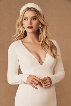 Knit crepe with a hint of stretch makes it easy to dance all night in this sleek, long-sleeved gown. A plunging notched v-neckline and daring keyhole back lend the look a sultry edge.