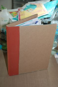 My cardboard journal made by Irene Young.  Covers are cardboard, pages are subscription cards from magazines stitched together.
