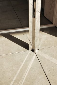 Barcelona Pavilion by Mies Van Der Rohe Stainless steel clad column &…