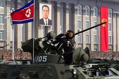 A tank driver salutes during a military parade celebrating the 100th anniversary of Kim Jong-Il's birthday